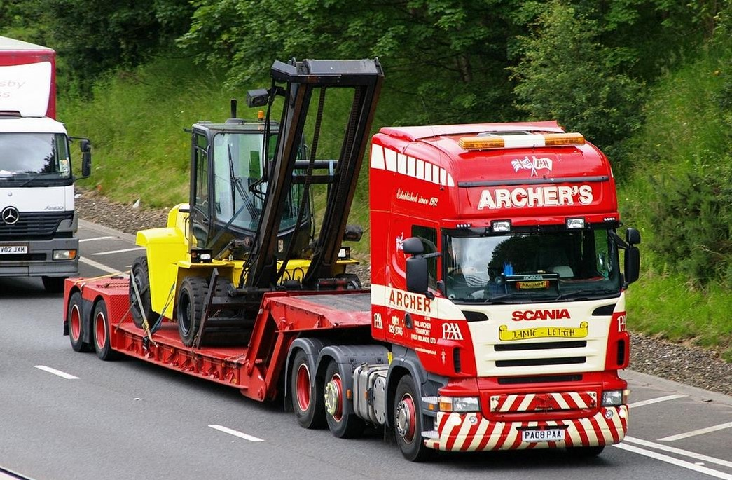 low loader transporting tall 8t counterbalance